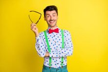 Portrait Of Attractive Cheerful Guy Showman Mc Wearing Print Shirt Isolated Over Bright Yellow Color Background