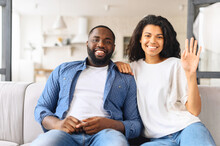 Portrait Of Just Married Hispanic Couple In Love, Posing Photo Shooting, Seated On Couch In Modern Studio Apartments, Concept Of Capture Happy Moment, Harmonic Relationships, Care Sincere Feelings