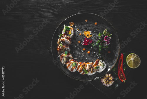 Fototapeta sushi roll in plate on wooden table background obraz