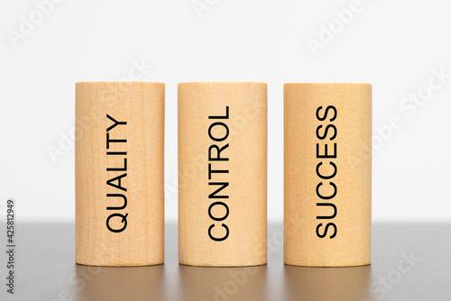 Obraz na plátně quality, control and success printed on three pillars