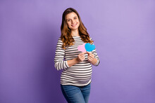 Photo Portrait Of Pregnant Woman Holding Small Pink And Blue Heart Cards Isolated On Vivid Violet Colored Background