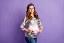 Photo Portrait Of Pregnant Woman Holding Small Pink Heart Card Isolated On Vivid Violet Colored Background