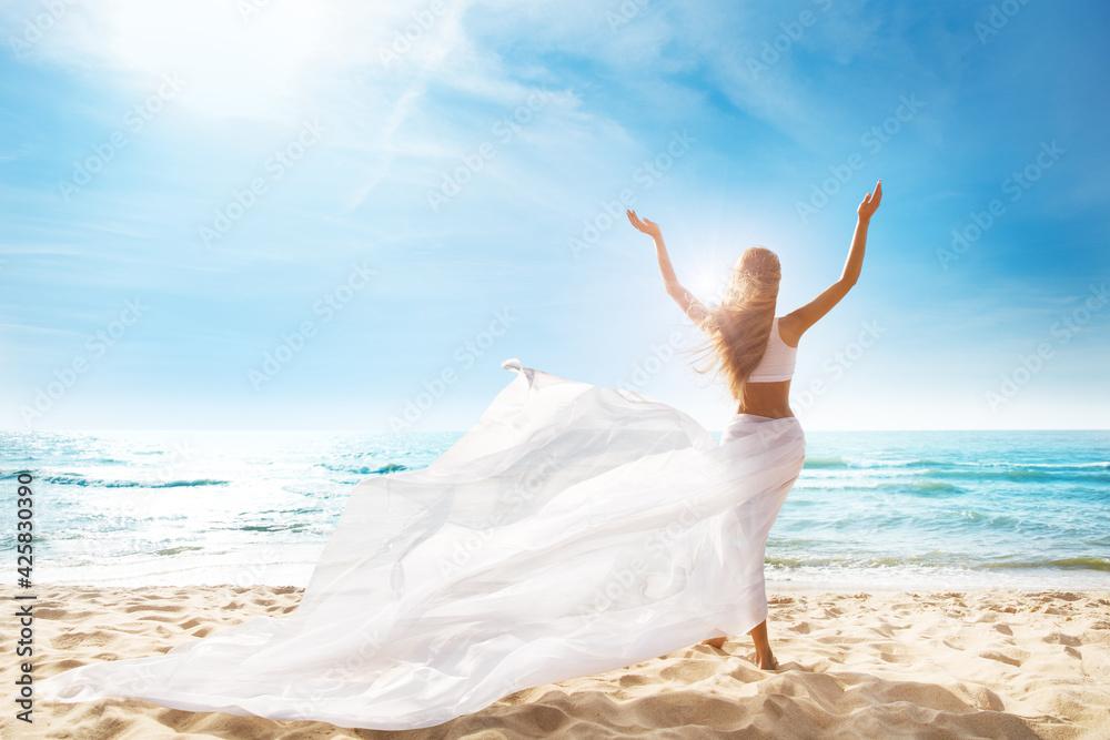 Fotografie, Obraz Happy Freedom Woman on Beach Enjoying Sun Arms Outstretched