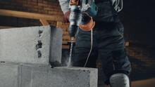 Crop Builder Drilling Concrete Brick