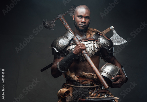Dangerous equipped antique warrior with helmet and axe Wallpaper Mural