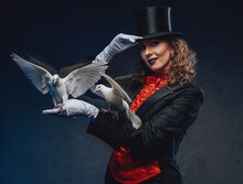 Amusing Actress Posing With Two White Pigeons In Dark Background