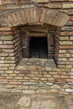 Bread Oven In An Ancient Bakery In The Roman Ruins Of Italica. Spain.