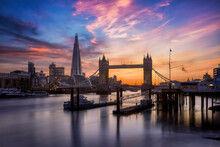 Beautiful Sunset View To The Skyline Of London, United Kingdom, With The Famous Tower Bridge And Modern Skyscrapers Along The Thames River