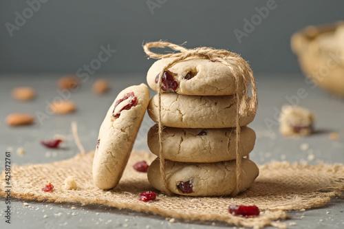Fototapeta Vegan almond cookies with dried cranberries.
