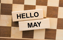 Chessboard With Wooden Blocks With Text Hello May