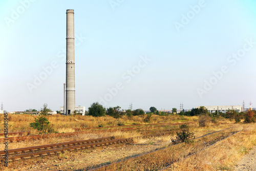 Fotografiet Abandoned chimney of an thermal power station, near the railways