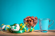 canvas print picture Muslim iftar of breaking of fast during Ramadan month with preserved sweet dates and water. Ketupat and pelita oil lamp as prop.