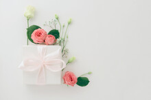 Mother's Day Card, Pink Background With White Flowers And A Present Postcard Gift, Flatlay Copyspace Background