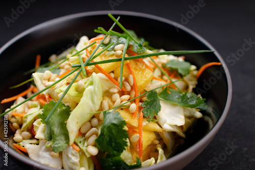 Mango and cabbage tasty fresh vegetable salad Wallpaper Mural
