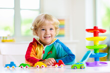 Boy Playing Toy Cars. Kid With Toys. Child And Car