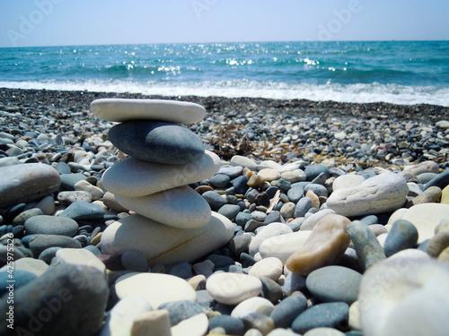 Billede på lærred Cairn by the sea, beautiful stones, blue sea, clear sky