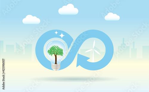 Fotografía Circular economy icon with lightbulb, wind turbines in city building background