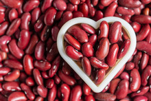 Red Bean Beans Together With A Heart Shape As Pattern Background