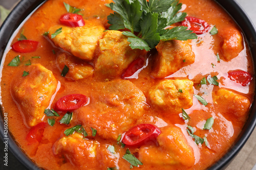 Bowl of delicious chicken curry, closeup view