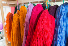 Raw Wool Available In Several Different Colors Displayed In A Traditional Shop In Ecuador.