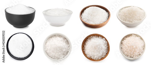 Bowls of different salt on white background