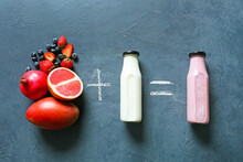 Composition With Bottles Of Tasty Smoothie, Milk And Fruits On Dark Background