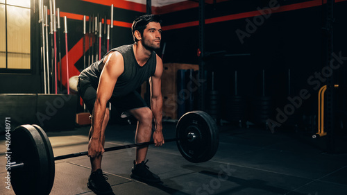 Fotografia Workout barbell man lifting weight, Strength man trainer bodybuilding achievement goals lifting barbell at gym fitness