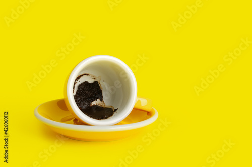 Fotografie, Obraz Cup with spent coffee grounds for fortune telling on color background