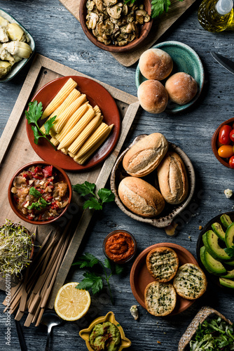 Canvas Print table full of vegan snacks, dips and side dishes