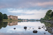 Carew Castle Reflected In The Mill Pond At Dawn, Pembrokeshire, Wales, United Kingdom