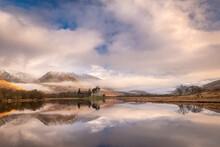 Kilchurn Castle Reflected In Loch Awe At Dawn In Winter, Highlands, Scotland, United Kingdom