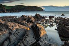 Evening Sunlight On The Rocky Shores Of Hope Cove, Devon, England, United Kingdom