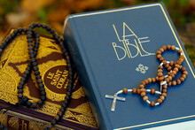 Holy Quran In French With Muslim Prayer Beads And Bible With Rosary, Interfaith Symbols Between Christianity And Islam, France