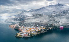 Mist Over Varenna Old Town And Lake Como After A Snowfall In Winter, Aerial View, Lecco Province, Lombardy, Italian Lakes, Italy