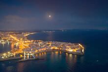 Aerial View Of The Coastal Town Of Gallipoli Illuminated At Night, Lecce Province, Salento, Apulia, Italy