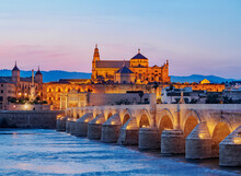 View Over Roman Bridge Of Cordoba And Guadalquivir River Towards The Mosque Cathedral, Dusk, UNESCO World Heritage Site, Cordoba, Andalusia, Spain