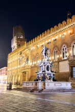 Night View Of The Fountain Of Neptune And D'Accursio Municipal Palace In The Historical Centre Of Bologna, Bologna, Emilia Romagna, Italy