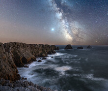 Long Exposure Of The Milky Way Above The Cape Of Pen Hir, Brittany, France