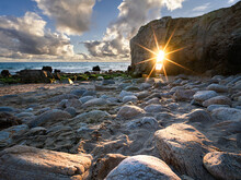 Sun Burst Aligned With The Natural Arch Of Port Blanc, Quiberon, Brittany, France