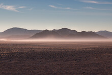 Misty Sunrise In The Rocky Desert, Namibia