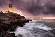 Sur Lighthouse With The Stormy Sea On The Cliff And A Pink Sunset, Sur, Oman, Middle East