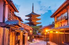 Ancient Buddhist Temple Of Hokan-ji In Old Town Of Kyoto In The Early Night. Blue Glowing Sky Contrasts With Traditional Pagoda