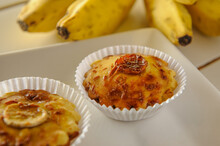 Homemade Banana Patties On A White Plate With Blurred Background Bananas.