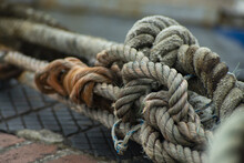 Closeup Of Old And Thick Mooring Rope In A Port