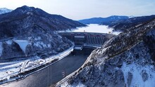 """Aerial View Over Sayano-Shushenskaya Hydroelectric Station Dam In Winter. A Sign On The Dam Means """"Russia"""""""