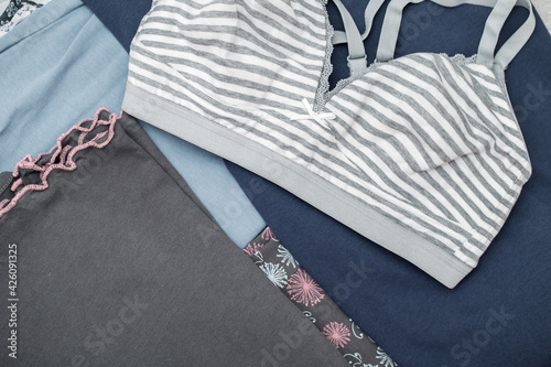 Fototapeta Cotton casual clothing, stacked in piles