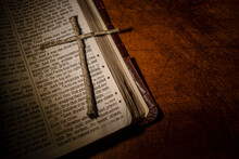 Tree Twigs Forming Cross On Old Open Bible
