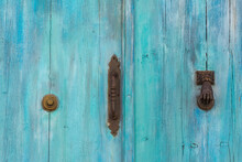 Beautiful Door Detail With Turquoise, Aged Wood And Iron Handle, Knocker And Doorbell