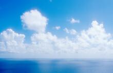 White Cumulus Clouds Over Calm Sea