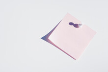 Studio Shot Of Blank Pink Adhesive Post It Note